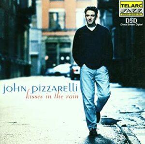 『キスィズ・イン・ザ・レイン』(Kisses in the Rain)- ジョン・ピザレリ(John Pizzarelli)